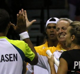 Owner Russell Geyser, second from right, congratulates Raven Klaasen of South Africa and Kveta Peschke of Czech Republic. At rear, Somdev Devvarman of India.