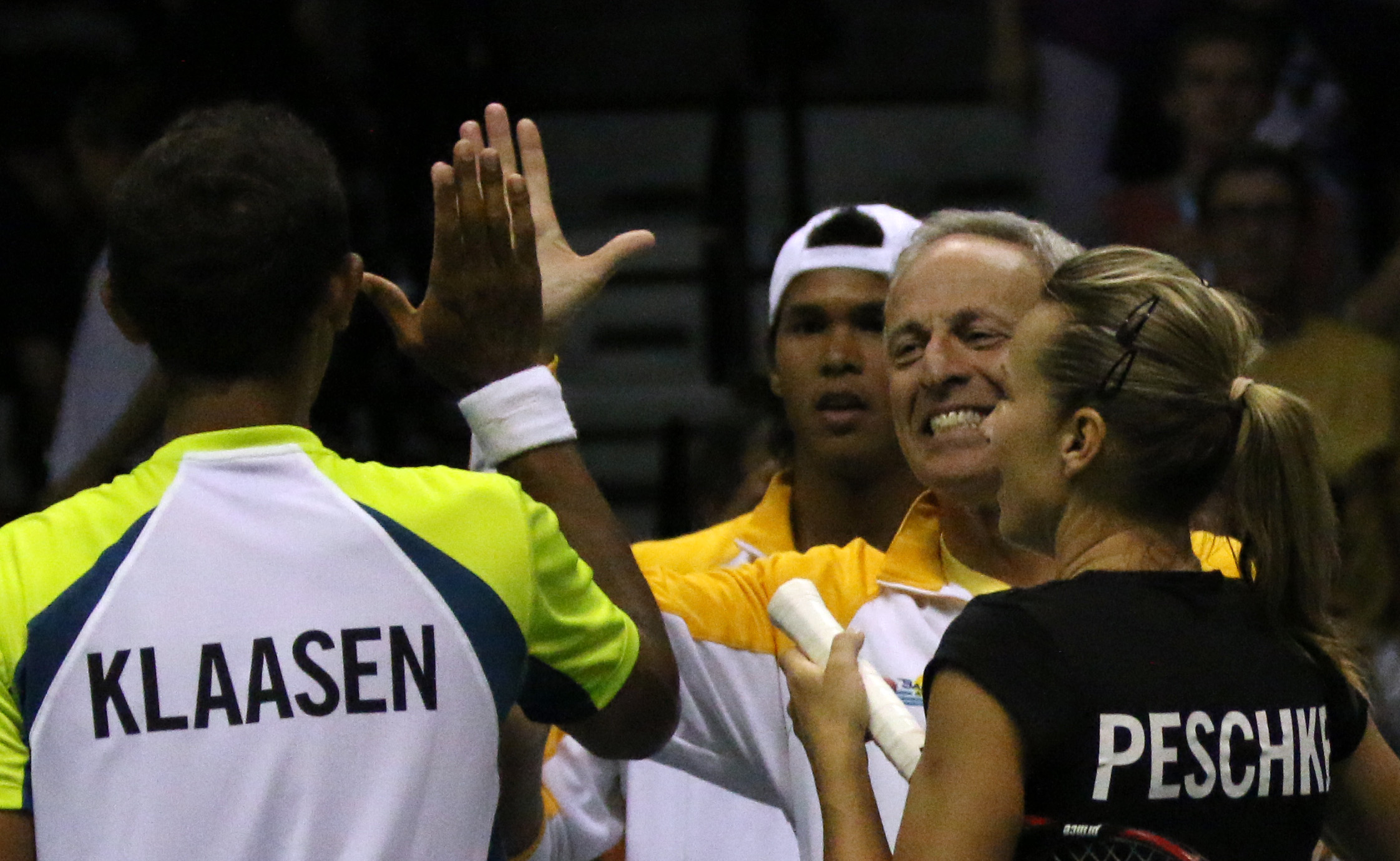 Russell Geyser high fives Raven Klaasen after Klassen and Kveta Peschke won the doubles match against the Austin Aces