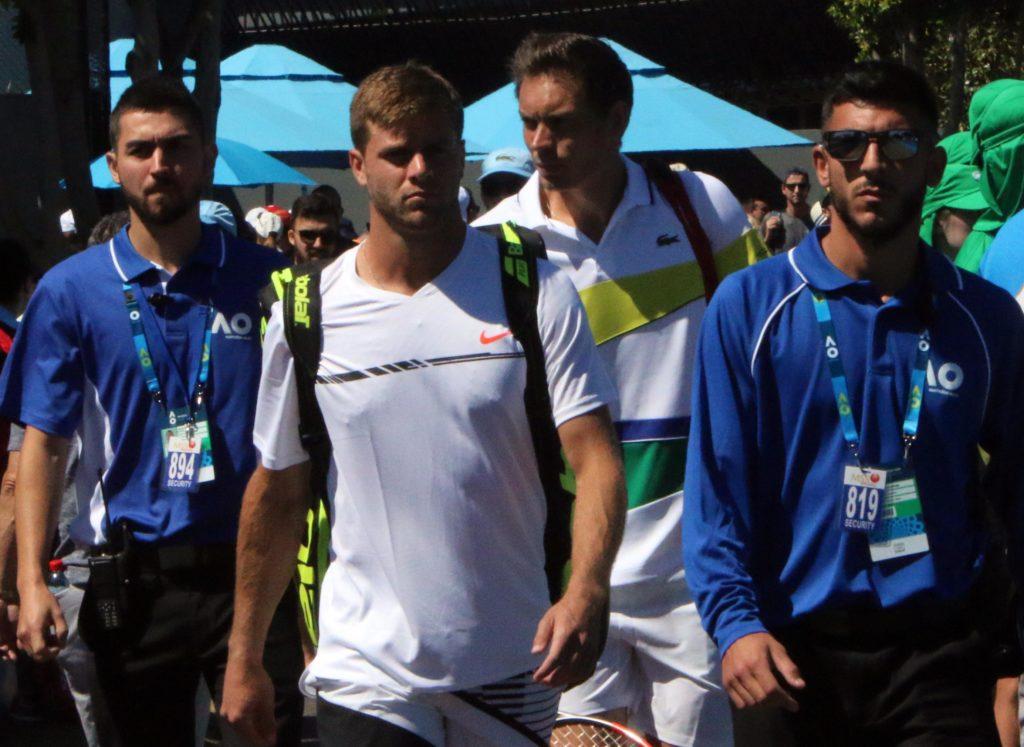 Ryan Harrison and Nicholas Mahut security walk Jan 16 2017 Australian Open